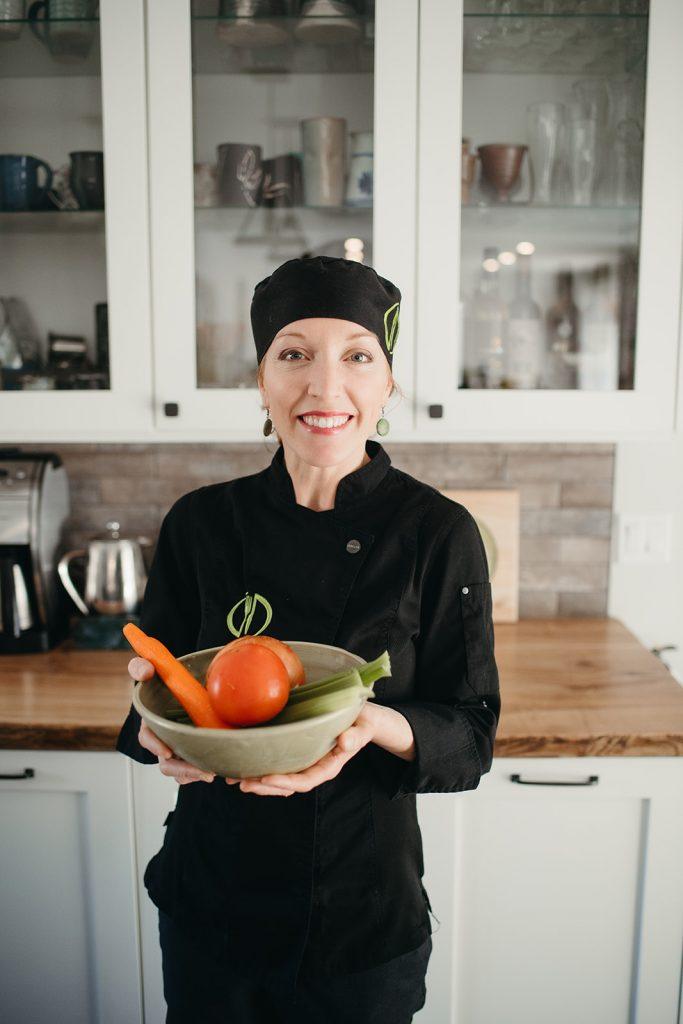 Rhonda holding bowl of vegetables